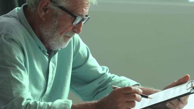 old man reading  form - instructions stock videos & royalty-free footage