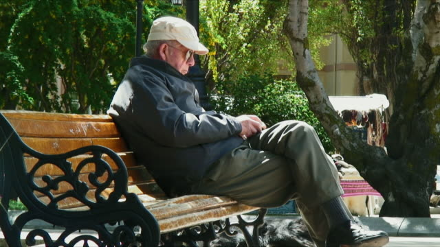 MS Old man relaxing on chair / Punta Arenas, Chile