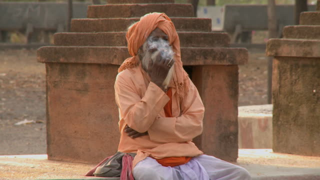 ms old man smoking in temple / rajkot, india - tobacco product stock videos & royalty-free footage