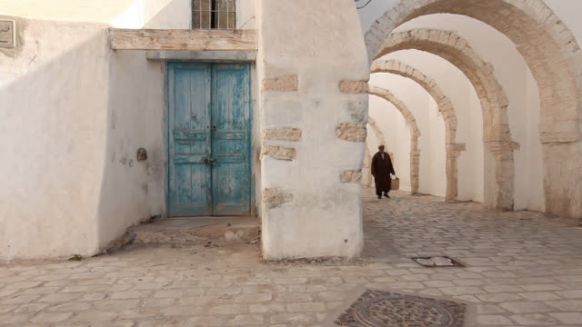 Old man walking in olg Djerba
