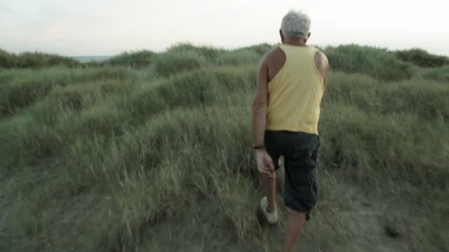 MS POV Old man walking near beach / Corsept, Loire Atlantique, France