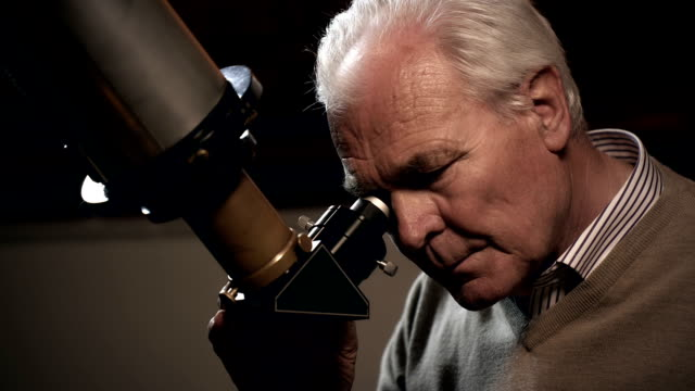 old man with telescope - astronomy telescope stock videos & royalty-free footage