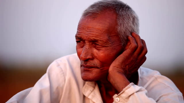 old men sitting portrait outdoor in the nature - sad old asian man stock videos & royalty-free footage