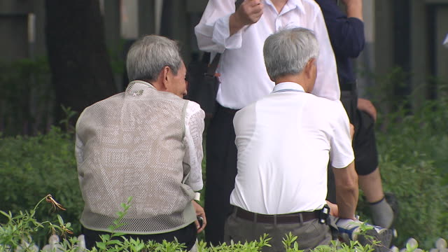 ms old men talking each other at tapgol park / seoul, south korea - south korea stock videos & royalty-free footage