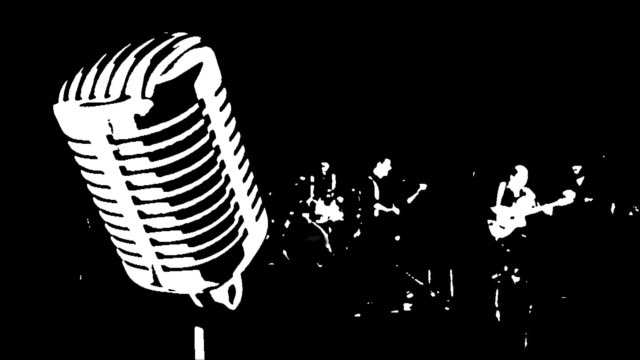 old microphone and the silhouettes of musicians