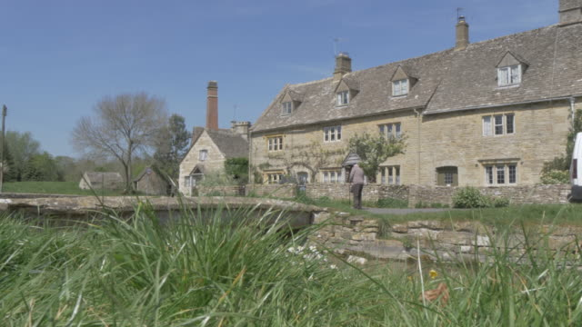 old mill museum and river eye in lower slaughter, cotswolds, gloucestershire, england, united kingdom, europe - cotswolds stock videos & royalty-free footage