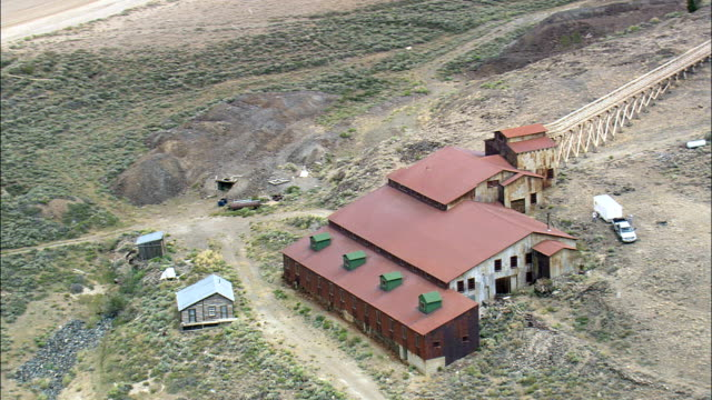 old mine at south pass city  - aerial view - wyoming,  fremont county,  helicopter filming,  aerial video,  cineflex,  establishing shot,  united states - wyoming stock videos & royalty-free footage