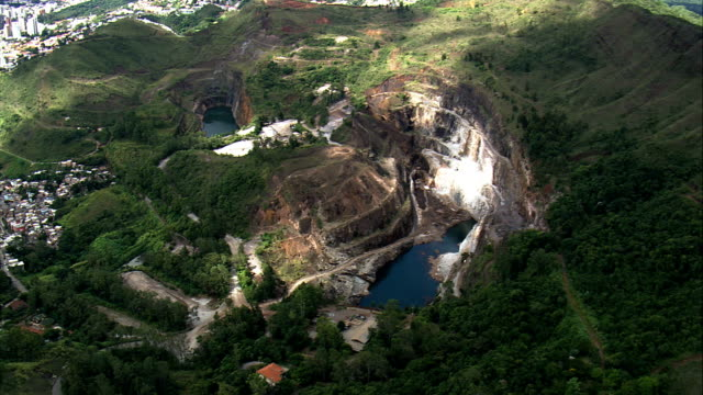 old mining holes near belo horizonte  - aerial view - minas gerais, brazil - mining natural resources stock videos & royalty-free footage
