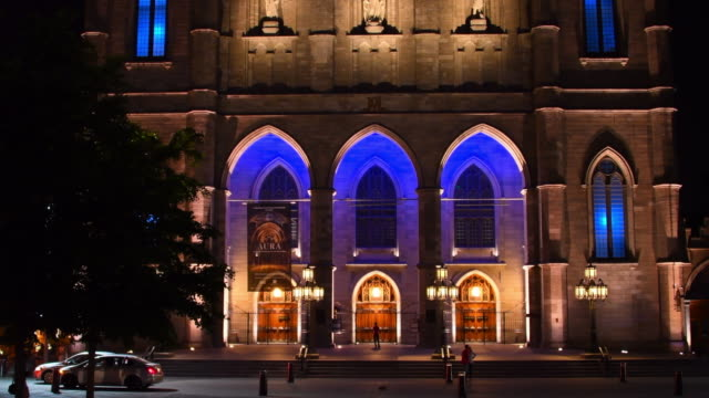 Old Montreal, Canada: Notre Dame Basilica entrance at night, establishing shot