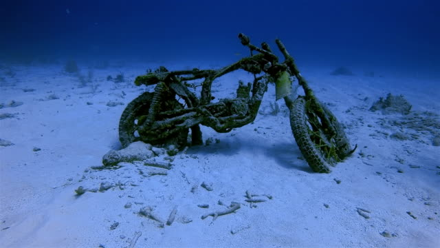 Old motorcycle in Caribbean Sea near Akumal Bay - Riviera Maya / Cozumel , Quintana Roo , Mexico