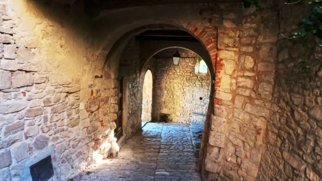 old narrow street in a village in tuscany - stabilized shot stock videos & royalty-free footage