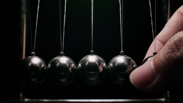 slo mo old newton's metal balls - gravitational field stock videos & royalty-free footage