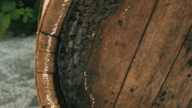 old oak brown barrel rolls on the ground closeup - rustic stock videos & royalty-free footage
