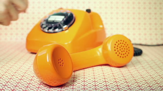 old orange telephone - dial phone number - telephone receiver stock videos & royalty-free footage