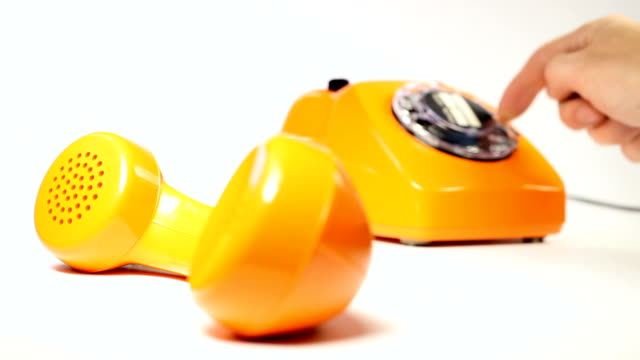 old orange telephone - dial phone number - rotary phone stock videos and b-roll footage