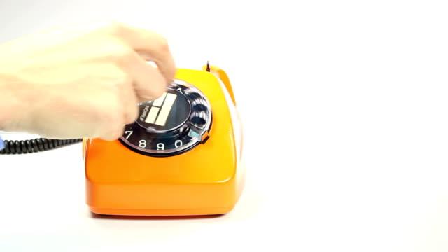 旧オレンジの電話 - 受話器点の映像素材/bロール