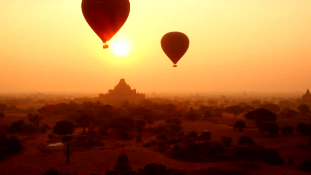 old pagoda in bagan, myanmar at silhouette sunrise - hot air balloon stock videos & royalty-free footage