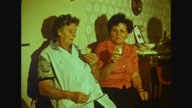 gdr / old people in the living room celebrating and drinking alcoholics / shot in 1976 / 1706004 - senior women stock videos & royalty-free footage