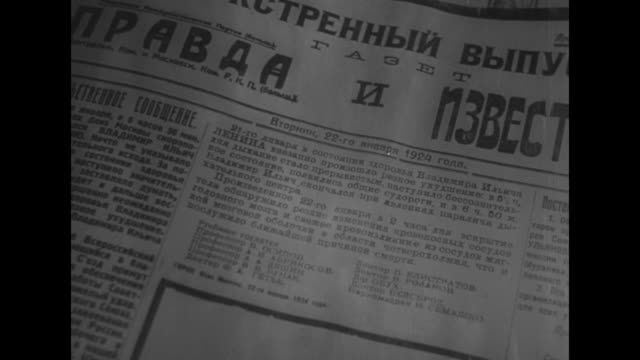 Old photograph Joseph Stalin with Vladimir Lenin / CU Pravda newspaper dated 22 January 1924 in Russian headlined with article about Lenin's death /...