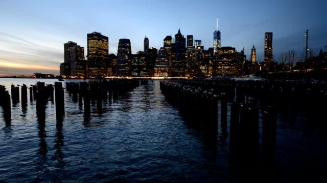 Old pier woods in Brooklyn and Manhattan skyline