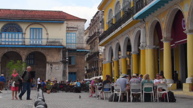 'old plaza' in old havana historic center which is a unesco world heritage site, cuba - ワイドショット点の映像素材/bロール