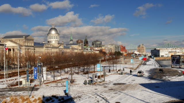old port of montreal in winter– looking over  promenade du vieux-port.  pont jacques-cartier bridge – medium shot - vieux montréal stock videos & royalty-free footage