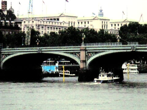 old postcard effect; police boat on london thames river - police boat stock videos and b-roll footage
