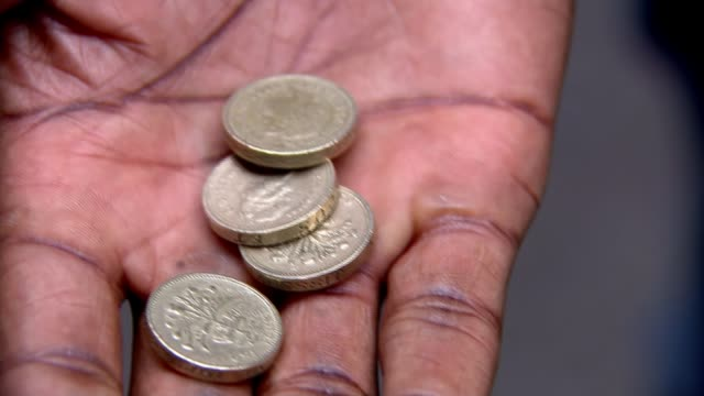 old pound coins to cease to be legal tender from tomorrow england london ext old pound coins taken from bag old pound coins held in hand various of... - coin stock videos & royalty-free footage