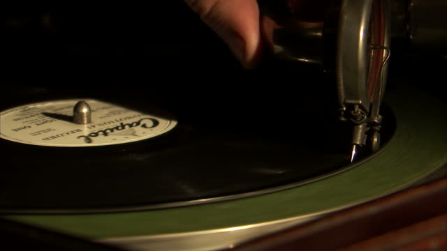 CU Old record needle dropping onto spinning record
