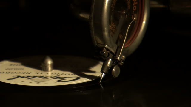 CU Old record needle on top of rotating record