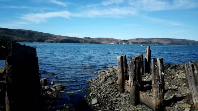 old remains of pier on edge of bay of water - marin stock videos & royalty-free footage