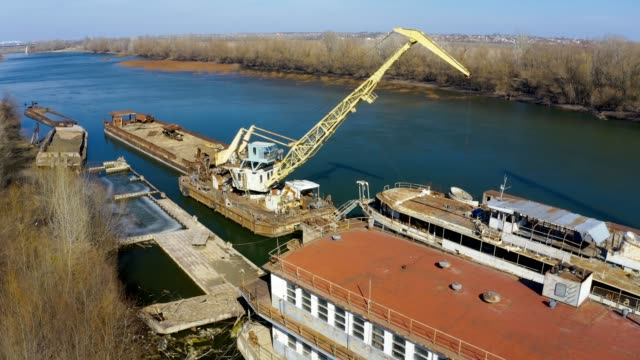 old repair dock - barge with a crane on the river - canal stock videos & royalty-free footage