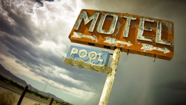 old route 66 motel sign in thunderstorm - motel stock videos and b-roll footage