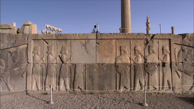 ws old ruin with bas relief, persepolis, iran - bas relief stock videos & royalty-free footage