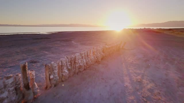 old ruined pier at the salton sea - drone shot - southern california stock videos and b-roll footage