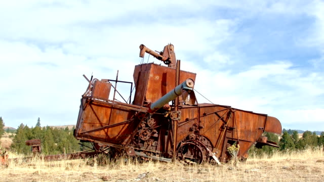 Old rusting combine tractor 1940 timelapse Western Ranch Oregon 33