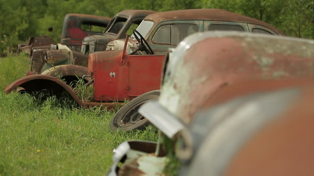 old rusty cars in a scrap car field - imperfection stock videos & royalty-free footage