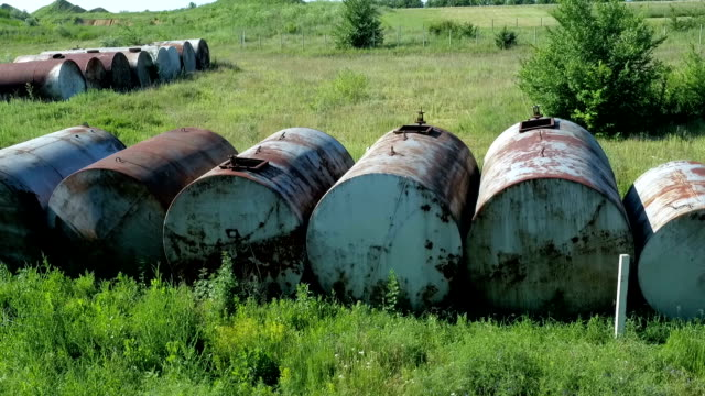 old rusty tanks waiting to be utilized - toxic waste stock videos & royalty-free footage