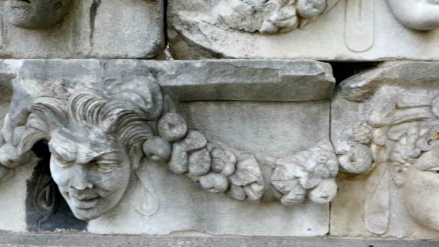 old sculptures on the walls in aphrodisias antique city - greek mythology stock videos and b-roll footage