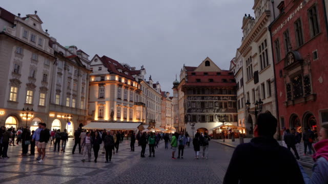 old square containing crowd of traveller in prague at evening, czech republic - prague stock videos & royalty-free footage