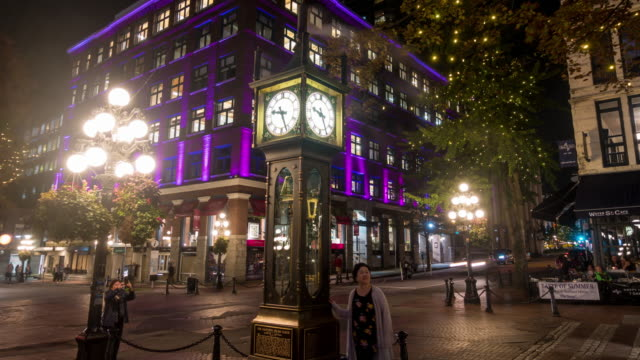 old steam clock in vancouver's historic gastown district at night in canada - downtown stock videos & royalty-free footage