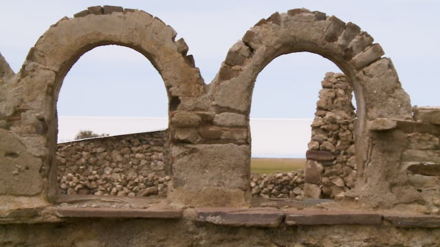 old stone arches of adobe church, uyuni, bolivia - bolivian andes stock videos & royalty-free footage
