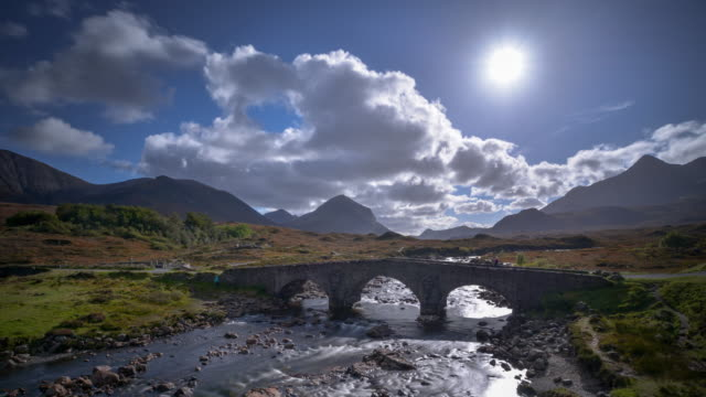 Old stone bridge over the river Sligachan and a view of the Cuillin mountains on the Isle Of Skye in the Scottish Highlands