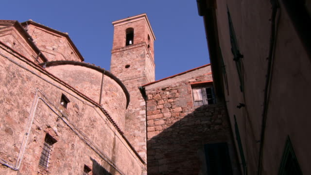 old stone building with bell tower in lucca, tuscany - bell tower tower stock videos and b-roll footage