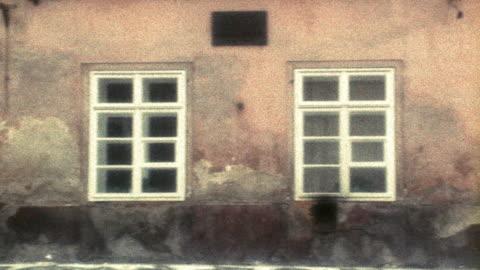 pan old stone buildings with doorways, windows, + gate / prague, czech republic - czech republic stock videos & royalty-free footage