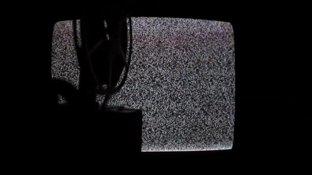 Old Style 8mm Film Projector On Television Static Background