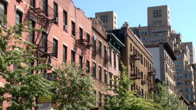 old style brick apartment buildings - greenwich village nyc - 非常階段点の映像素材/bロール