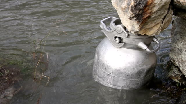 old style refrigerator for milk canister - milk churn stock videos & royalty-free footage