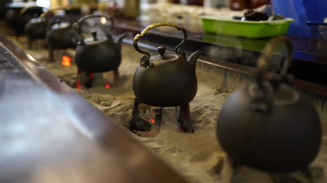 old teapots on fireplace - taipei stock videos & royalty-free footage