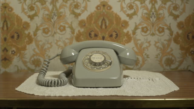 f/s old telephone ringing, crochet tablecloth, pattern wall background - landline phone stock videos and b-roll footage